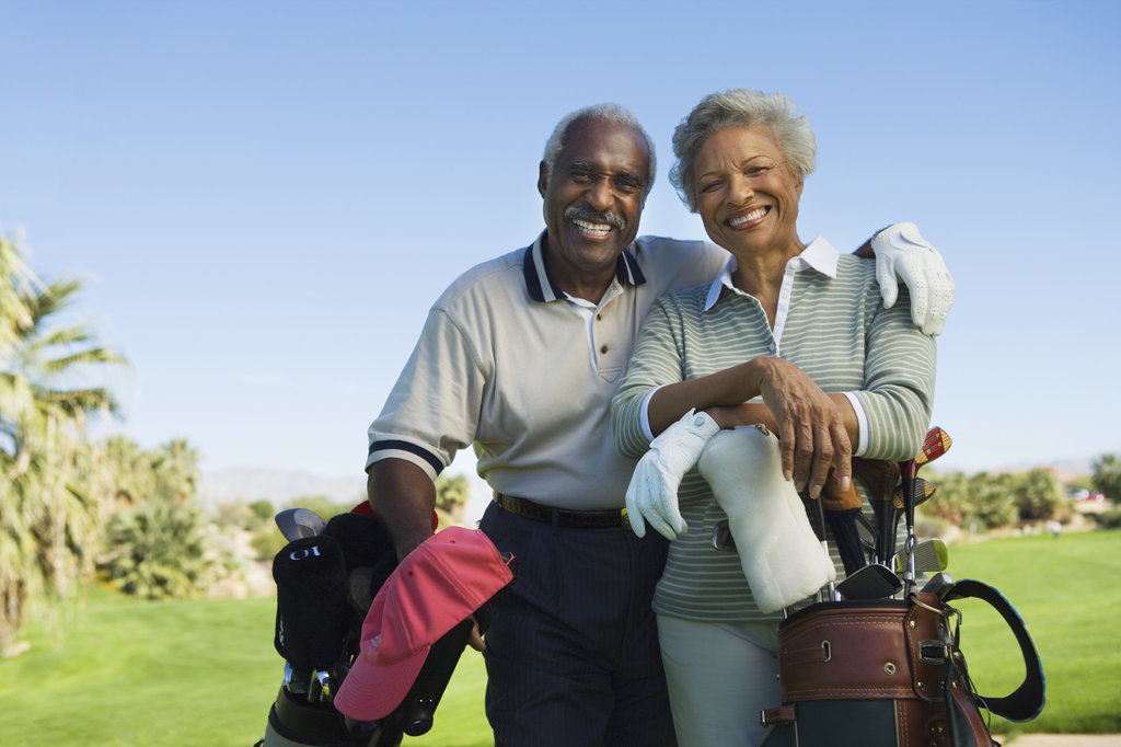 over 55 couple at a golf course